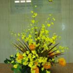 [花]オンシジューム、マリーゴールド、[葉]コンシンネ、モンステラ、丸葉ルスカス